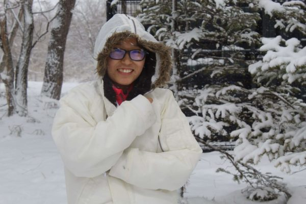 Covid-19 Has Strengthened My Character Lhamo Moving Dorms during the heavy snowfall wrapped up in a coat